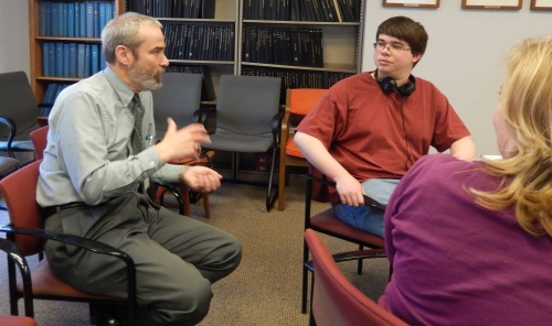 Society researcher Eric Mease talks to a student about the Rev. Brown.