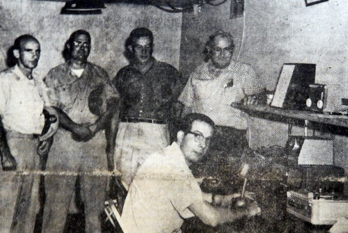 In August 1961, Jack Cooke, chief operator, tests the county's central dispatching center as officials prepare to launch the network in a couple of months.  Looking on (L to R) are two Bainbridge officials, G. Mitchell Boulden, and John J. Ward.  Source:  Cecil Democrat, August 2, 1961