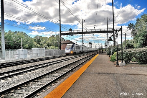 A northbound Amtrak Acela rushes past the Perryville Depot.