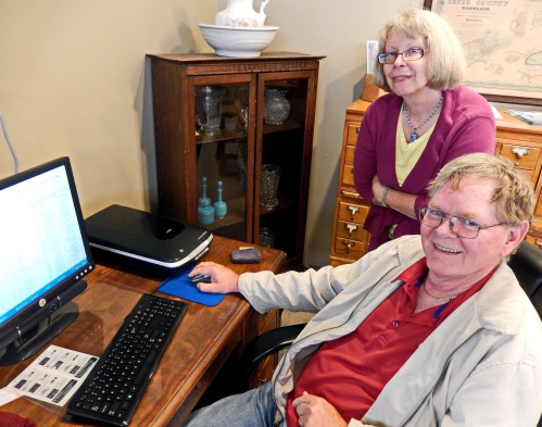 Librarian Carol Donache and Steve Higham examine the Cecil County Civil War Bounty digital research product.