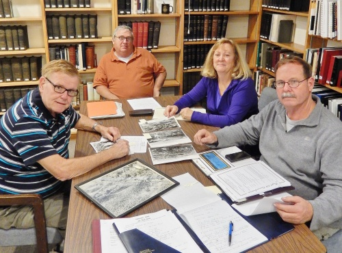 Singerly Fire Company members work with research materials at the Historical Society.  Around Table from L to R -- Carl Edelin, Past President, Maryland State Firemen's Association; Bob McKinney & Eileen Edelin, Singerly Fire Co. Museum; Carson Widdoes, Singerly Director;