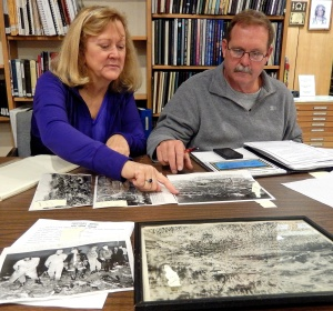Eileen Edelin & Carson Widdoes work with Historical Society photographs.