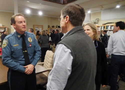 Acting Elkton Police Chief Matthew Donnelly talks to the Knuth family during the reception for family members.