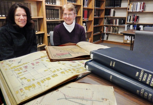 Wendy Webb and Darlene McCall work on materials for their upcoming lecture.