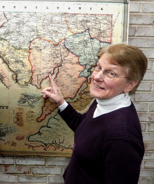 Darlene McCall examines the Martinent's Map of Cecil County
