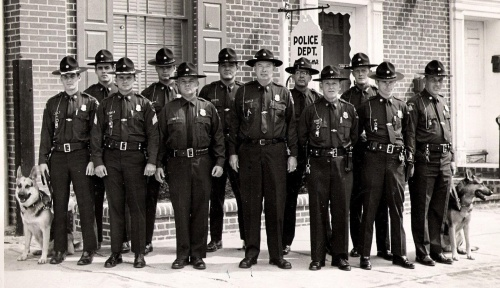 The police force, commanded by Chief Thomas N. McIntire, Jr. stands in front of headquarters in 1968.  Office Purner is in the 2nd row, 4th from left.  Photo Credit:  Veasey