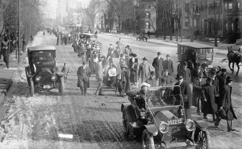 General Jones marching through Newark, NJ.  The general is marching behind the automobile.  source:  Library of Congress.